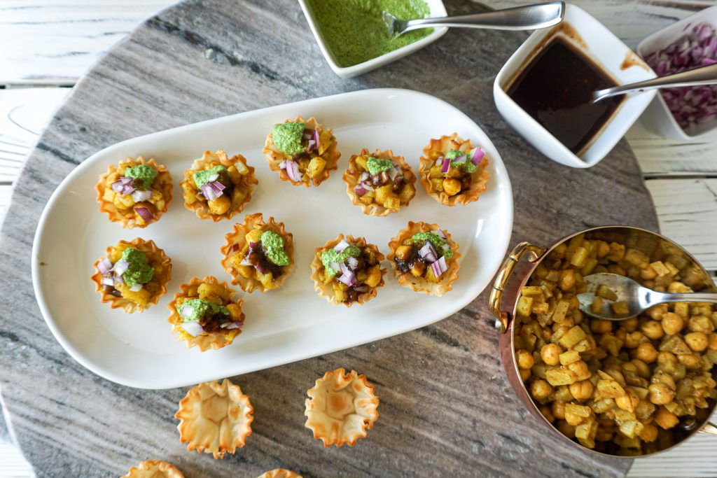 Phyllo shells filled with potato and chickpea mixture topped with chutneys