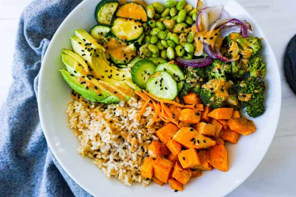 Roasted vegetables, brown rice, and peanut sauce.