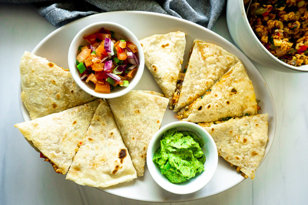crumbled tempeh quesadillas with pico and avocado