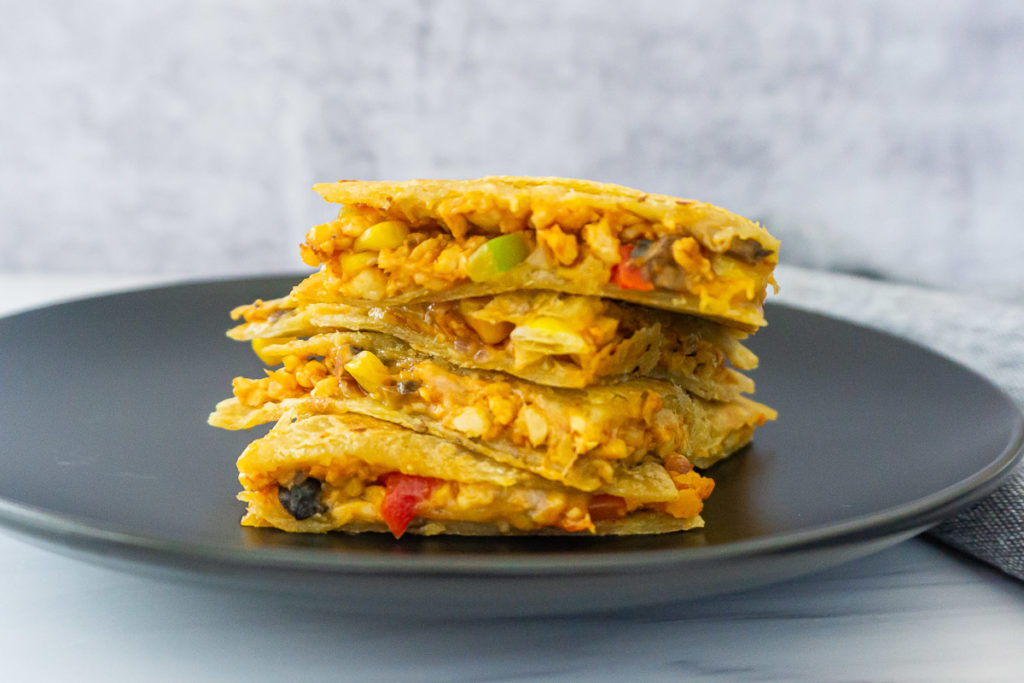 Stacked Tempeh quesadilla on a plate