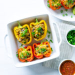 bell peppers with couscous, black beans, cheese, and seasonal vegetables