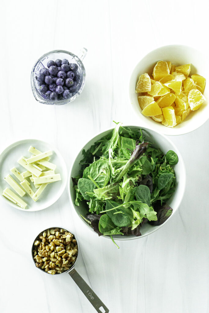 Ingredients for citrus and blueberry salad
