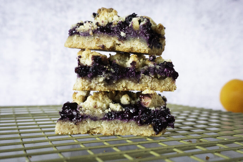 stacked vegan blueberry almond crumb bar made with almond flour