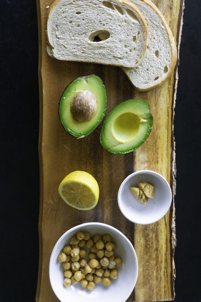 Sourdough bread, avocado, lemon, miso paste, and chickpeas